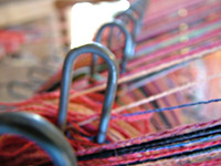 Close-up of warp threads in the studio of Gretel Underwood