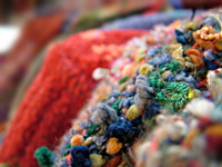Detail of handwoven jackets by Gretel Underwood